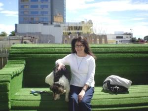 Sally and Jogi on a huge  fake grass sofa - Christchurch NZ.